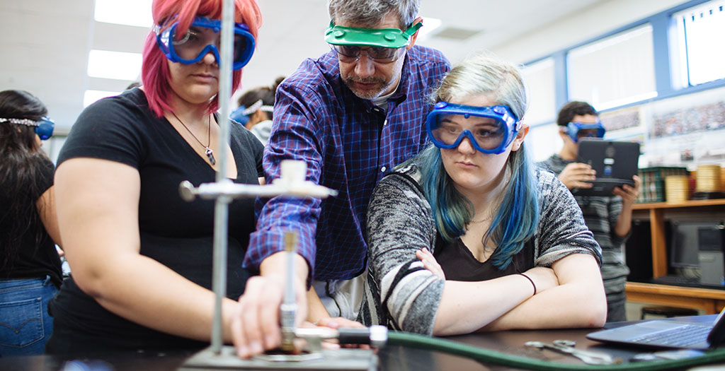 teacher and students work on chemistry